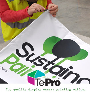 Quality Painting logo on a banner sign