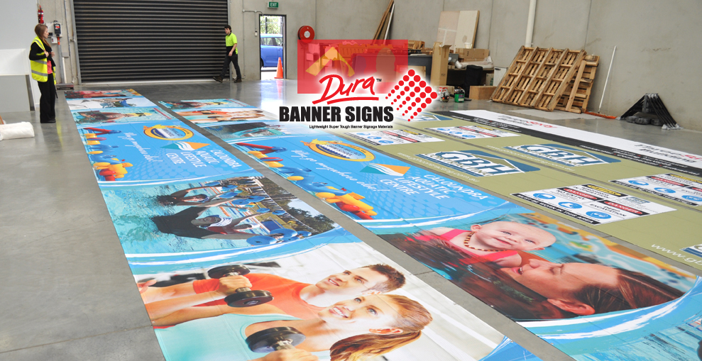 The banner sign company in action making signage